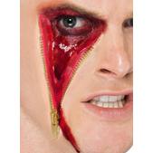 Herida de cara con cremallera